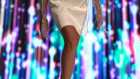 Female model walks the runway in beautiful white designer dresses during a Fashion Show. Fashion Live Action