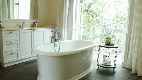 Interior view of bathroom with bathtub Live Action