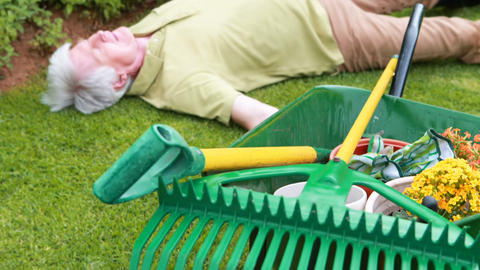 Senior man lying unconscious in garden Live Action