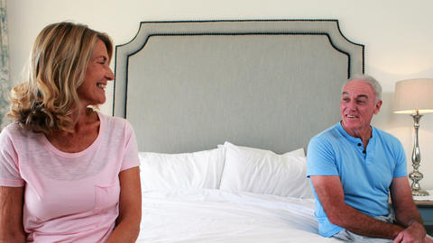 Senior couple interacting with each other in bedroom Live Action