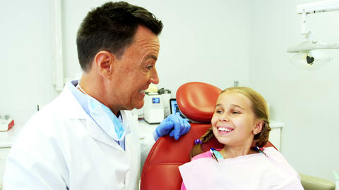 Dentist interacting with young patient Live Action