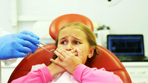 Young patient scared during a dental check-up Live Action