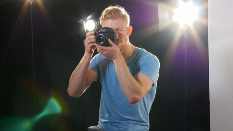 Male photographer photographing with digital camera Live Action