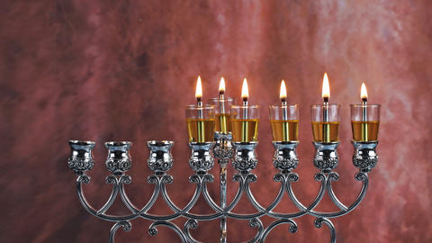Fifth day Hanukkah candles are burning on light of the Jewish holiday Live Action