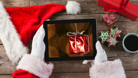 Christmas animation of digital tablet showing hanging Christmas gift 4k Animation