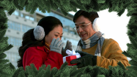 Christmas tree border with couple giving gift Animation