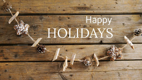 Happy holidays text and Christmas wood Animation