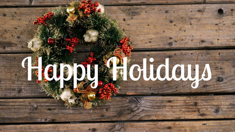 Happy holidays text and Christmas wreath Animation