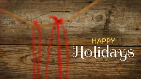 Happy holidays text and Christmas bells Animation