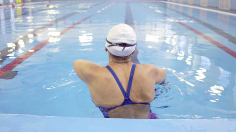 Female Swimmer Training in Swimming Pool Live Action