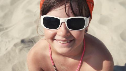 102 portrait child girl smiling sunglasses Footage