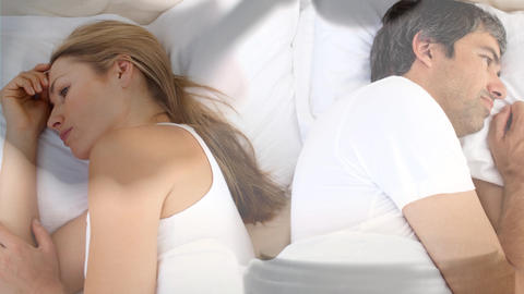 Digital animation of couple ignoring each other on bed 4k Animation