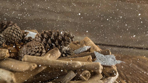 Falling snow with Christmas decorations on wood Animation