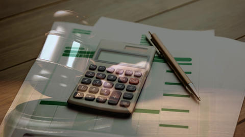 Digital animation of bills, calculator and pen on wooden table 4k Animation