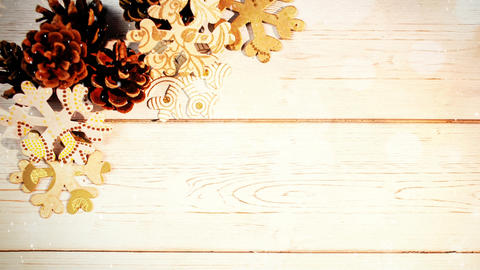Christmas decoration on wood combined with falling snow Animation