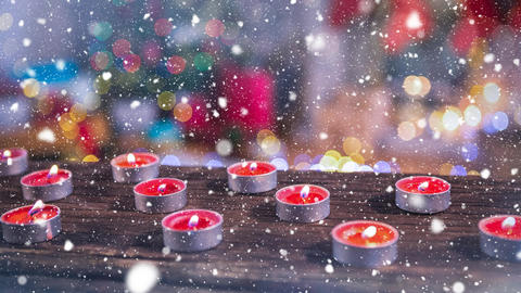 Candles combined with falling snow Animation