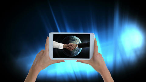 Hands holding tablet showing handshake video Animation