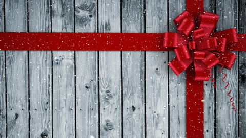 Video composition with snow over Christmas gift ribbon on wood Animation