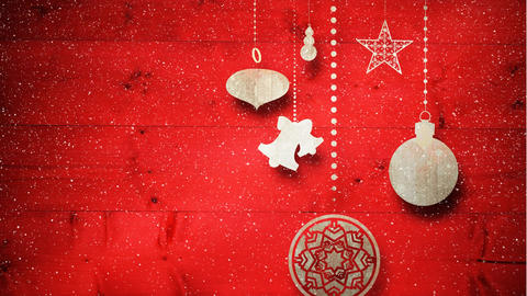 Video composition with snow over Christmas ornaments on wood Animation