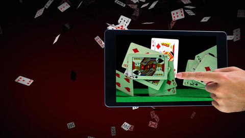 Hand using tablet showing poker cards video Animation