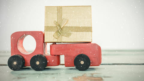 Red toy car with a present combined with falling snow Animation
