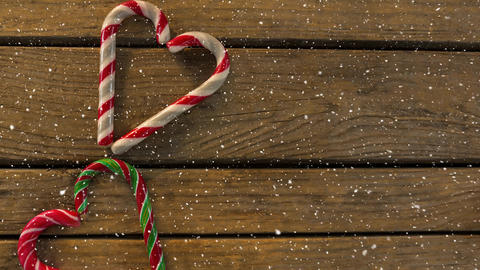 Falling snow with Christmas hearts decoration on wood Animation