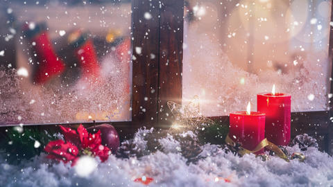 Candles and christmas decoration outside a window combined with falling snow Animation
