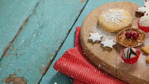 Falling snow with Christmas food Animation