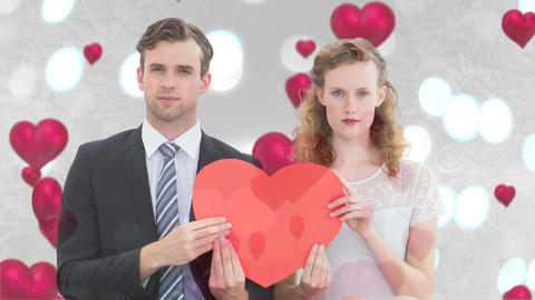 Newly wedded couple holding big red heart together Animation