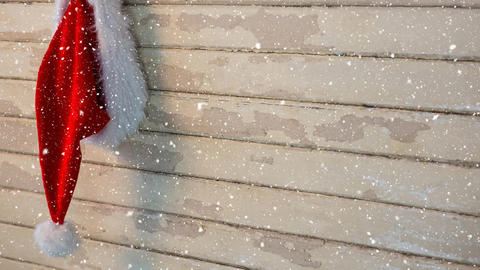 Falling snow with Christmas Santa hat on wood Animation