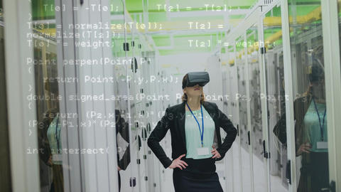 Woman using VR headset in server room Animation
