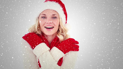 Video composition with falling snow over happy girl with santa hat smiling Animation