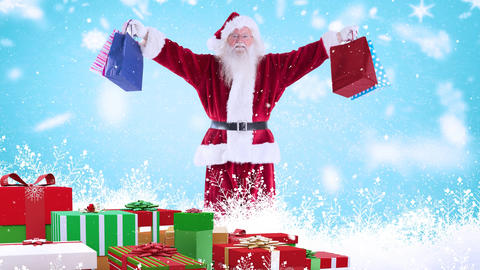 Santa clause with christmas presents combined with falling snow Animation
