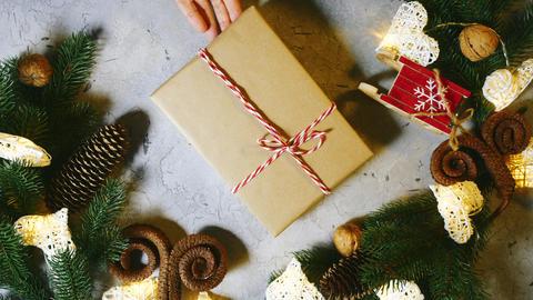 Good winter mood awaiting Christmas. Human hands put a Christmas present to the ライブ動画