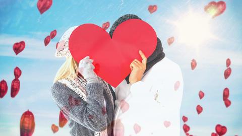Couple holding big read heart Animation