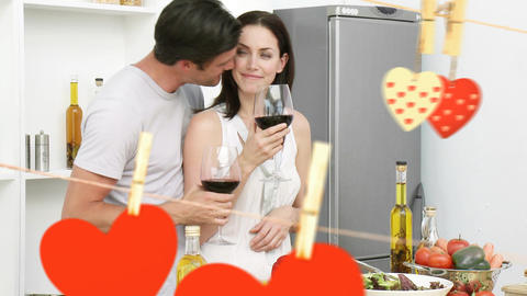 Happy young couple enjoying wine in kitchen Animation