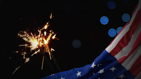 Digital animation of American flag and sparklers at night 4K Animation