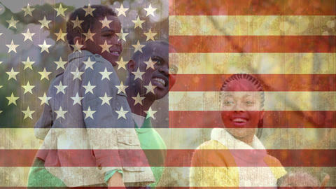 African American family spending time together against American flag Animation