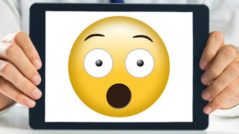 Tablet showing shocked animated smiley video Animation