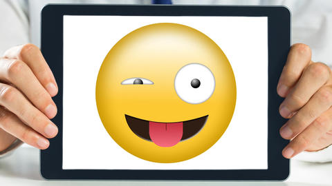 Tablet showing wink and tongue out Smiley Animation