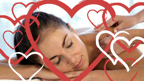 Masseuse doing massage to relaxed attractive women at spa with hearts for valentines day 4k Animation