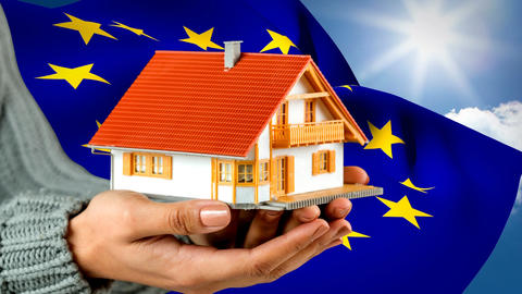 White and orange house with European flag waving in the background Animation