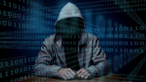 Digital animation of hacker sitting on table 4k Animation