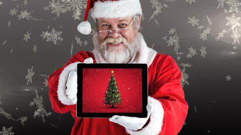 Christmas animation of happy Santa holding a digital tablet that displays Christmas tree 4k Animation