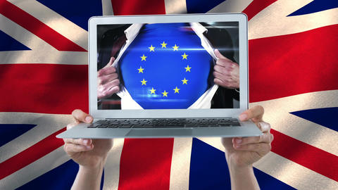 Man showing europe shirt on a laptop holded by hands with united kingdom flag Animation
