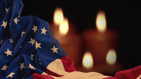 Digital animation of crumpled American flag against lit candles 4k Animation