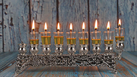 Seven Hanukkah candles are burning on light of jewish holiday sixth day of the Live Action