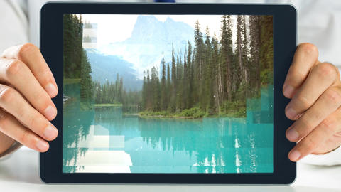 Tablet showing Forest landscape Animation