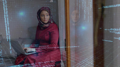 Woman wearing hijab taping quickly on laptop in her room with binary codes Animation