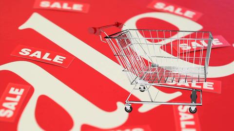shopping cart rotating on turning background with sale Animation